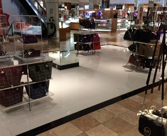 This image displays the tile flooring in the Macy's Coach Department. The tile in this image was installed by Youngstown Tile and Terrazzo.