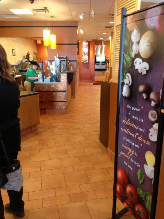 This image depicts a custom tile flooring for Panera Bread. This tile project was completed by Youngstown Tile & Terrazzo.