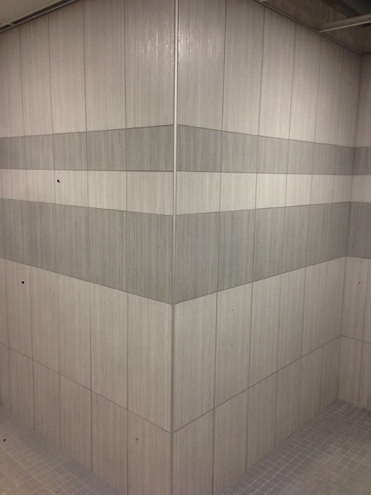 This image depicts a commercial tile installation at a pool and locker room. This project was completed by Youngstown Tile & Terrazzo.